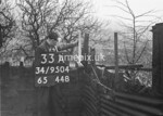 SD950433A, Man marking Ordnance Survey minor control revision point with an arrow in 1950s