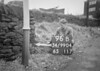 SD990496B, Man marking Ordnance Survey minor control revision point with an arrow in 1950s