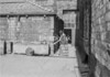 SD941722A, Man marking Ordnance Survey minor control revision point with an arrow in 1950s