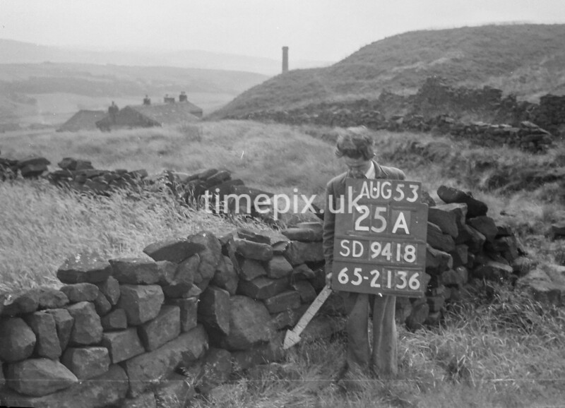SD941825A, Man marking Ordnance Survey minor control revision point with an arrow in 1950s