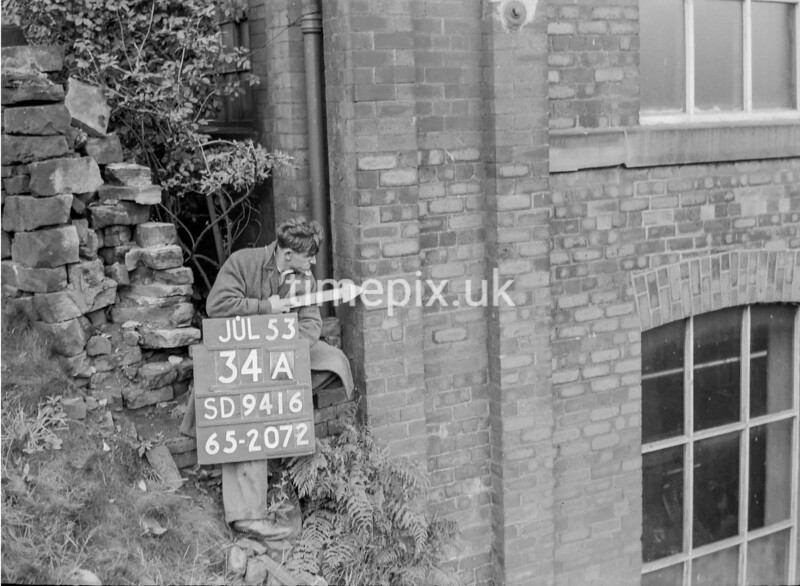 SD941634A, Man marking Ordnance Survey minor control revision point with an arrow in 1950s