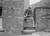 SD941634B, Man marking Ordnance Survey minor control revision point with an arrow in 1950s