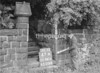 SD941647A, Man marking Ordnance Survey minor control revision point with an arrow in 1950s