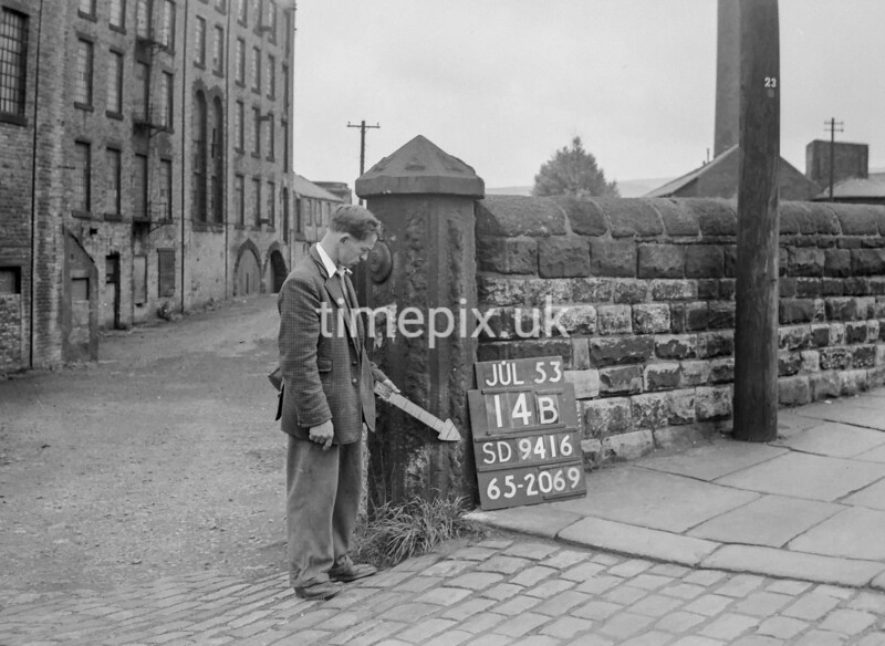 SD941614B, Man marking Ordnance Survey minor control revision point with an arrow in 1950s