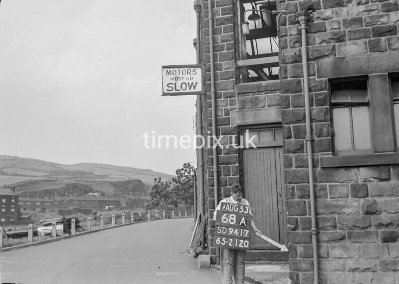 SD941768A, Man marking Ordnance Survey minor control revision point with an arrow in 1950s