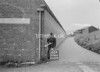 SD941622A, Man marking Ordnance Survey minor control revision point with an arrow in 1950s
