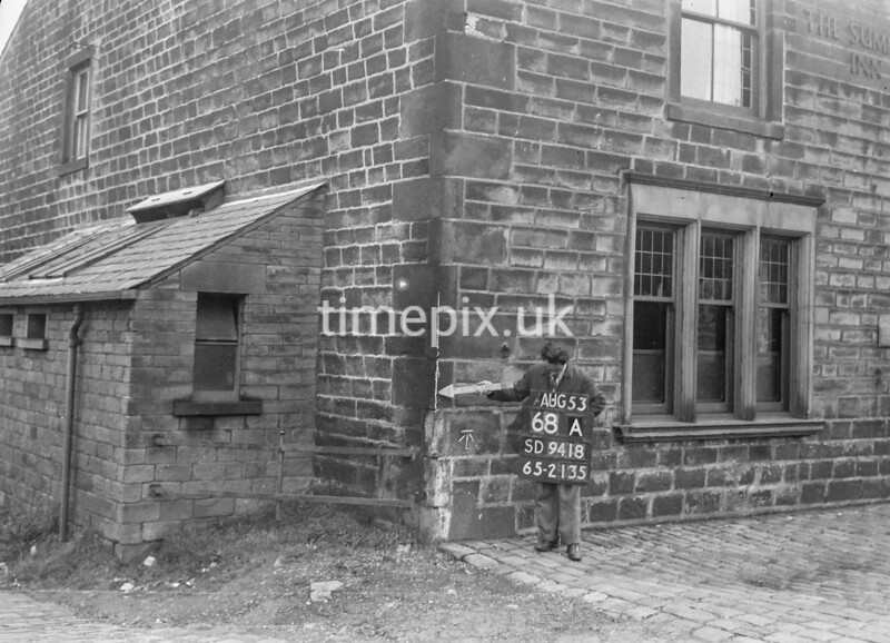 SD941868A, Man marking Ordnance Survey minor control revision point with an arrow in 1950s