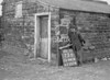 SD941673B, Man marking Ordnance Survey minor control revision point with an arrow in 1950s