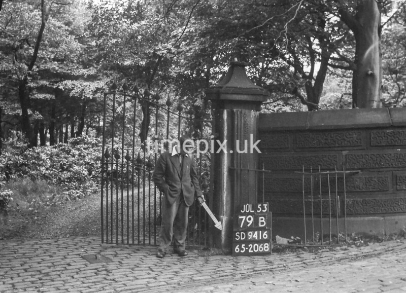 SD941679B, Man marking Ordnance Survey minor control revision point with an arrow in 1950s