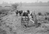 SD941512A, Man marking Ordnance Survey minor control revision point with an arrow in 1950s