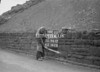 SD941290A, Man marking Ordnance Survey minor control revision point with an arrow in 1950s