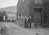 SD941867A, Man marking Ordnance Survey minor control revision point with an arrow in 1950s