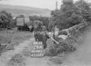 SD941626A, Man marking Ordnance Survey minor control revision point with an arrow in 1950s