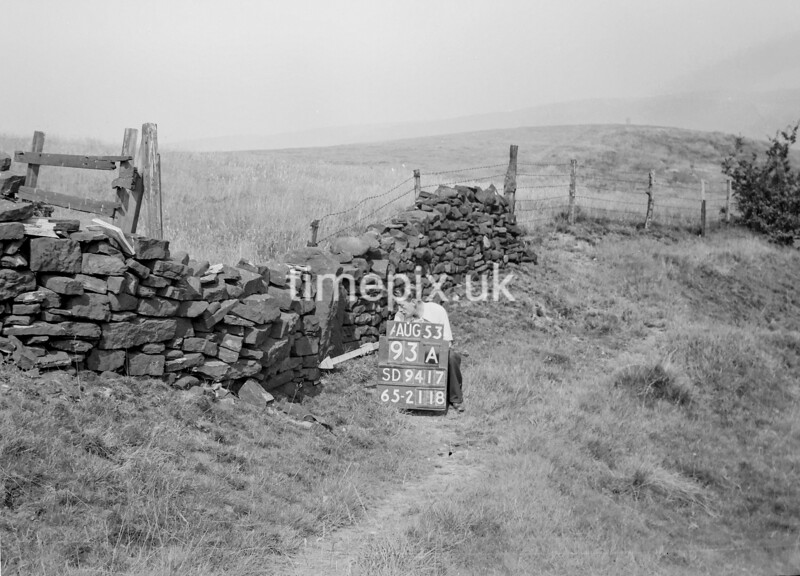 SD941793A, Man marking Ordnance Survey minor control revision point with an arrow in 1950s