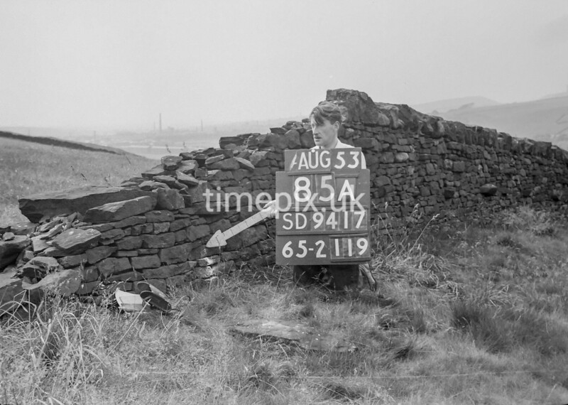 SD941785A, Man marking Ordnance Survey minor control revision point with an arrow in 1950s