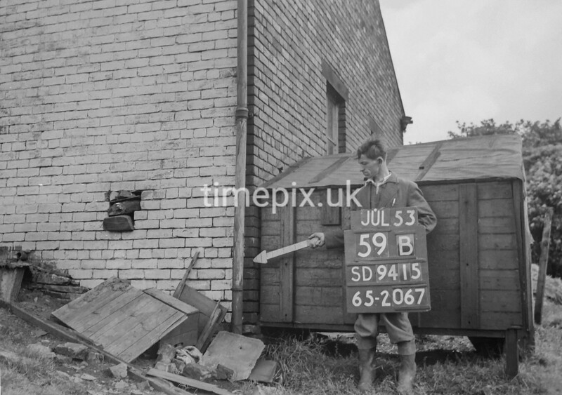 SD941559B, Man marking Ordnance Survey minor control revision point with an arrow in 1950s