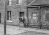 SD941856B, Man marking Ordnance Survey minor control revision point with an arrow in 1950s