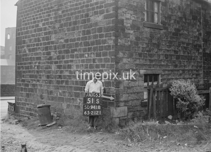 SD941851S, Man marking Ordnance Survey minor control revision point with an arrow in 1950s