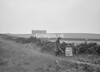 SD941308B, Man marking Ordnance Survey minor control revision point with an arrow in 1950s