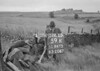 SD941559K, Man marking Ordnance Survey minor control revision point with an arrow in 1950s