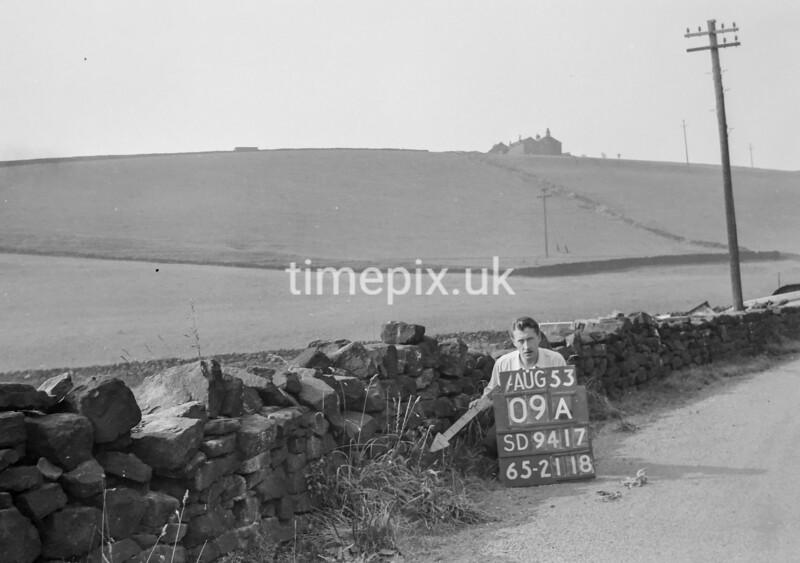 SD941709A, Man marking Ordnance Survey minor control revision point with an arrow in 1950s