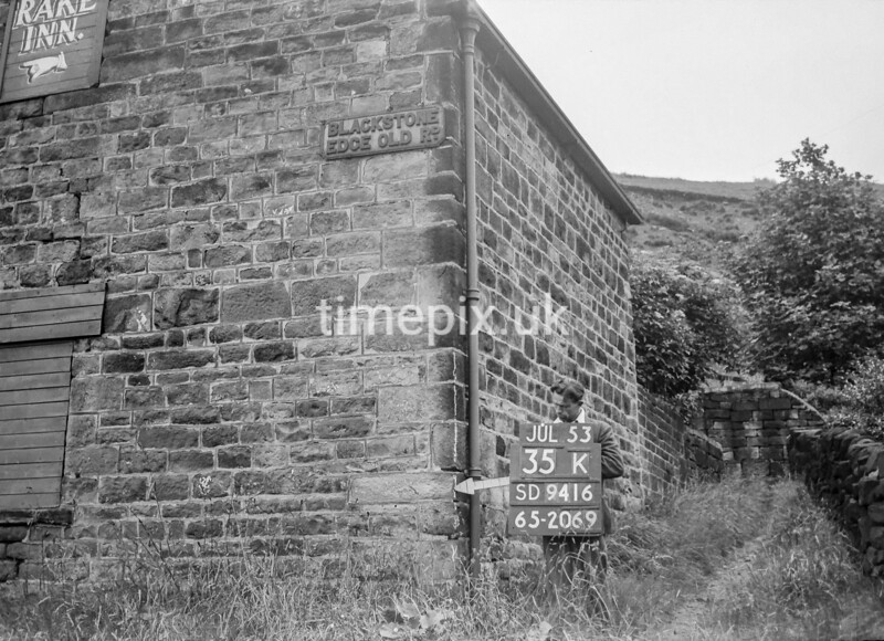 SD941635K, Man marking Ordnance Survey minor control revision point with an arrow in 1950s
