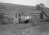 SD941763A, Man marking Ordnance Survey minor control revision point with an arrow in 1950s