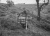 SD941220A, Man marking Ordnance Survey minor control revision point with an arrow in 1950s
