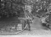 SD941679A, Man marking Ordnance Survey minor control revision point with an arrow in 1950s
