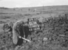 SD941207A, Man marking Ordnance Survey minor control revision point with an arrow in 1950s