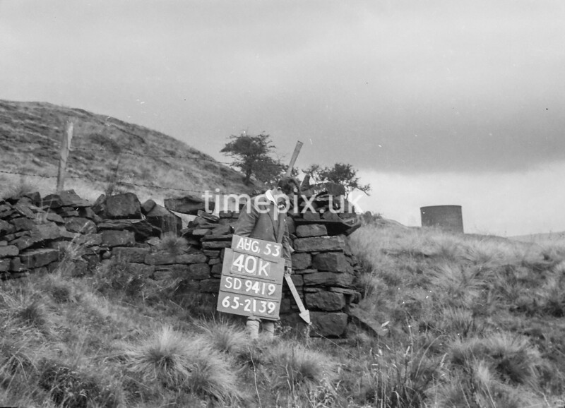SD941940K, Man marking Ordnance Survey minor control revision point with an arrow in 1950s