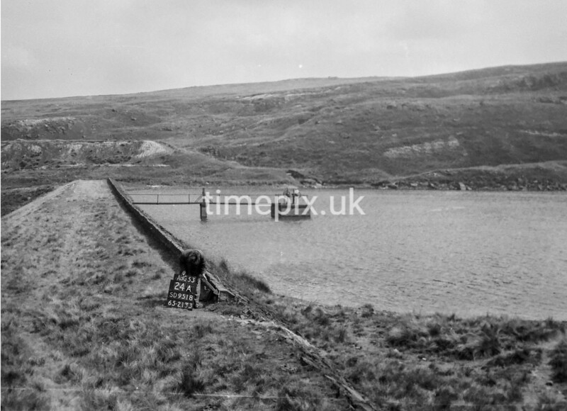 SD951824A, Man marking Ordnance Survey minor control revision point with an arrow in 1950s