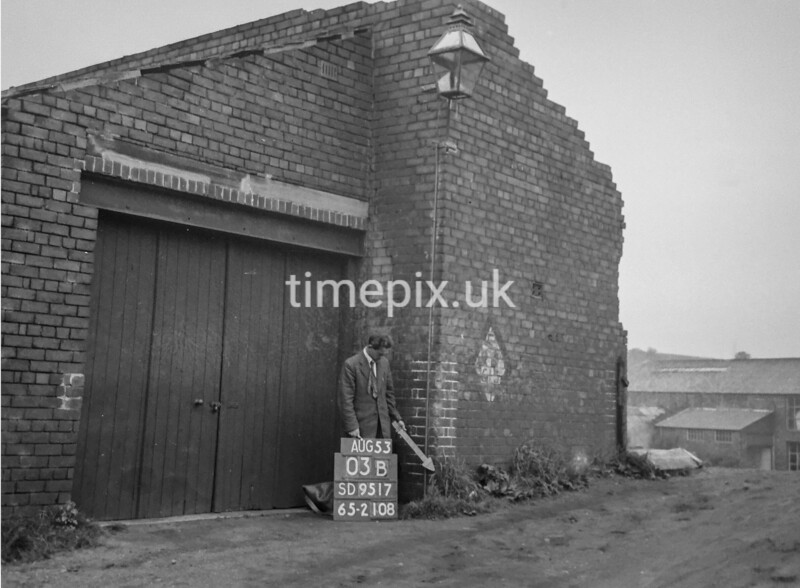 SD951703B, Man marking Ordnance Survey minor control revision point with an arrow in 1950s
