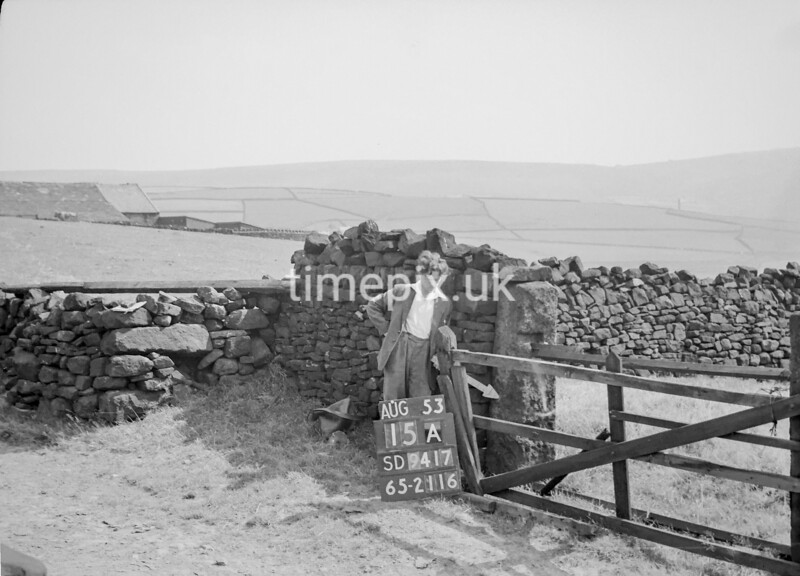 SD941715A, Man marking Ordnance Survey minor control revision point with an arrow in 1950s
