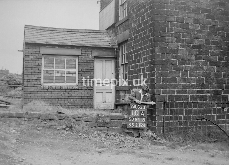 SD941810A, Man marking Ordnance Survey minor control revision point with an arrow in 1950s