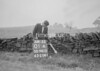 SD941501A, Man marking Ordnance Survey minor control revision point with an arrow in 1950s