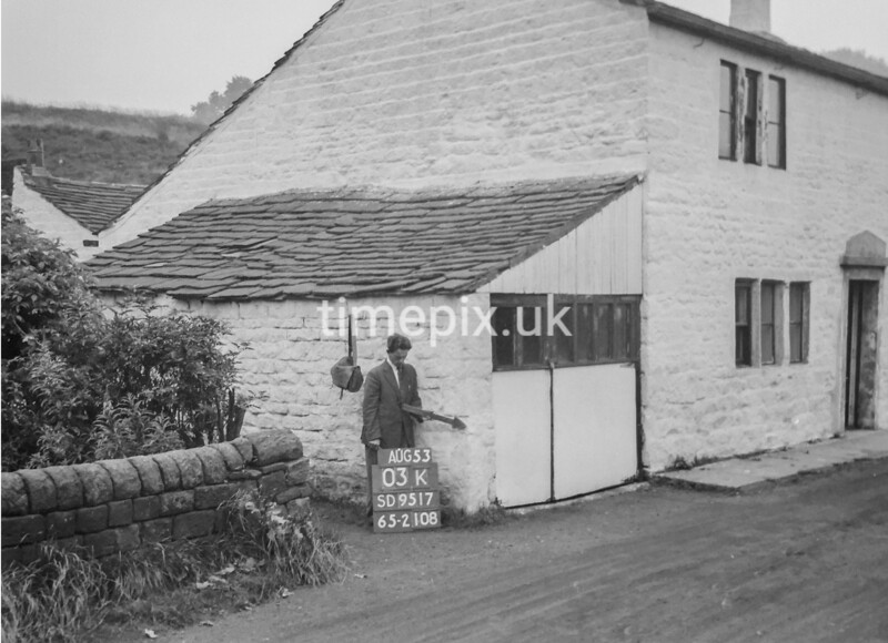SD951703K, Man marking Ordnance Survey minor control revision point with an arrow in 1950s