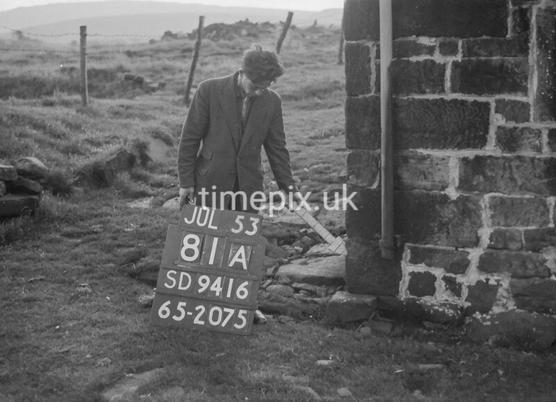 SD941681A, Man marking Ordnance Survey minor control revision point with an arrow in 1950s