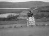 SD951200A, Man marking Ordnance Survey minor control revision point with an arrow in 1950s