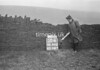 SD941250A, Man marking Ordnance Survey minor control revision point with an arrow in 1950s