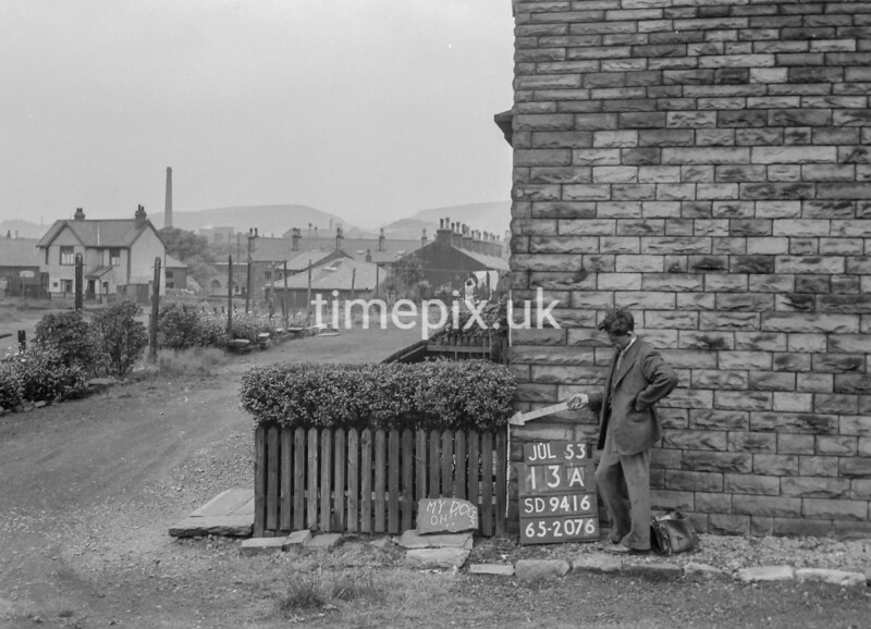 SD941613A, Man marking Ordnance Survey minor control revision point with an arrow in 1950s