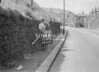 SD941863B, Man marking Ordnance Survey minor control revision point with an arrow in 1950s