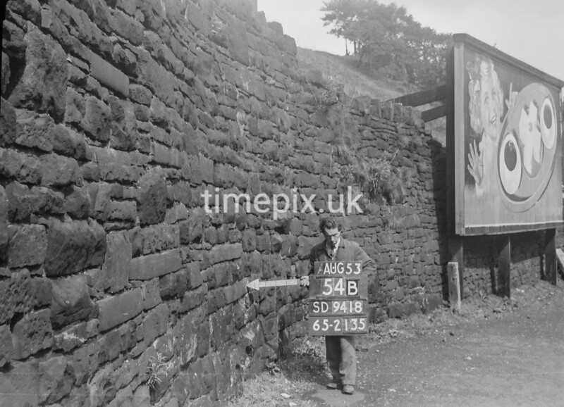 SD941854B, Man marking Ordnance Survey minor control revision point with an arrow in 1950s