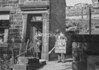 SD941734A, Man marking Ordnance Survey minor control revision point with an arrow in 1950s