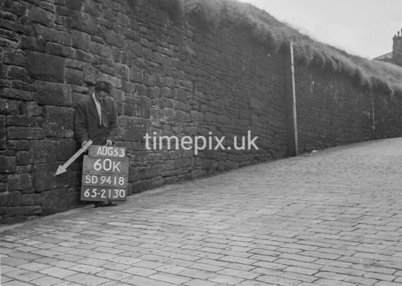 SD941860K, Man marking Ordnance Survey minor control revision point with an arrow in 1950s