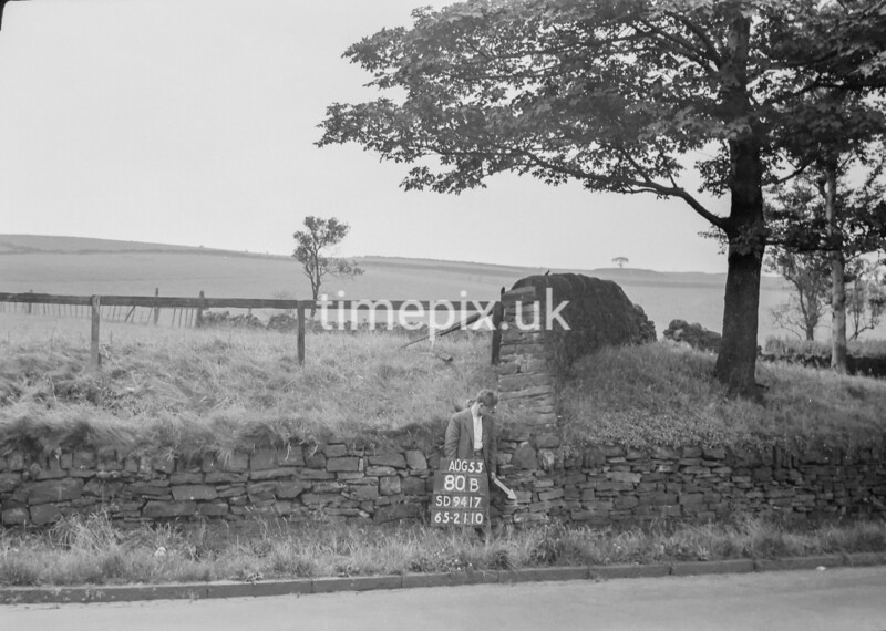 SD941780B, Man marking Ordnance Survey minor control revision point with an arrow in 1950s