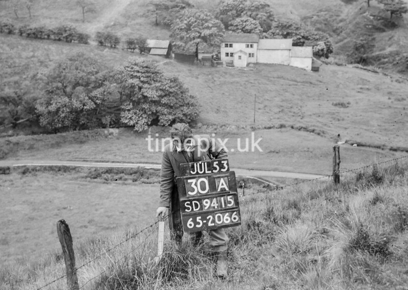 SD941530A, Man marking Ordnance Survey minor control revision point with an arrow in 1950s