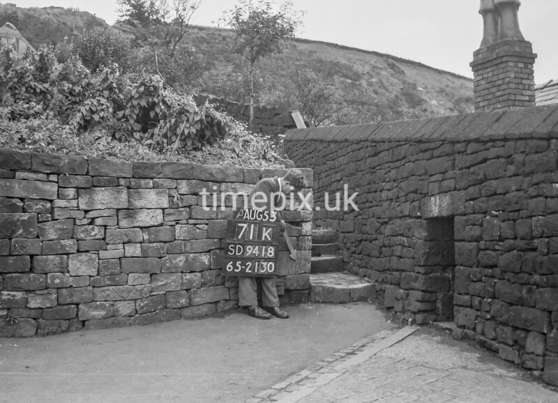 SD941871K, Man marking Ordnance Survey minor control revision point with an arrow in 1950s