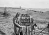 SD941241A, Man marking Ordnance Survey minor control revision point with an arrow in 1950s
