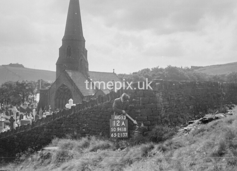 SD941812A, Man marking Ordnance Survey minor control revision point with an arrow in 1950s